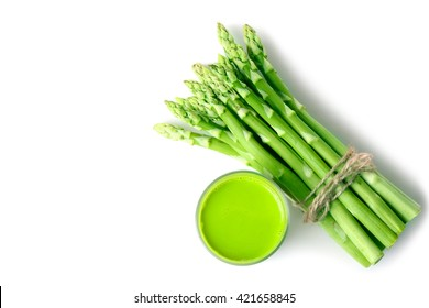 fresh asparagus wrapped with rope and fresh juice of asparagus in a glass on a white isolated background