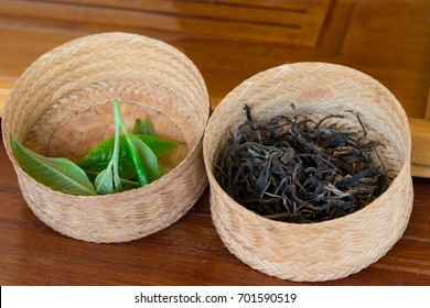 fresh assam tea leaves and dried assam tea leaves are in bamboo weave.