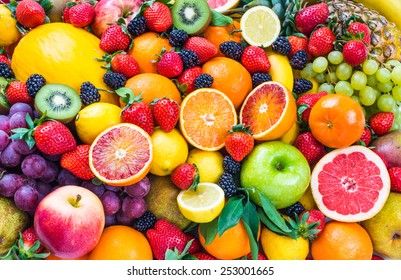 Fresh assorted fruits background.Love fruits, healthy food. - Shutterstock ID 253001665
