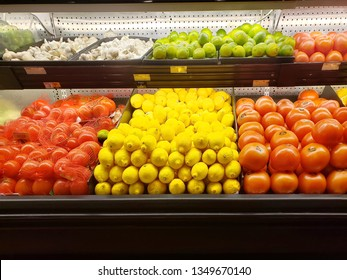 fresh assorted fruits and vegetables in a shelf of stater brothers, Perris.california .lemon, tomatoes, garlic