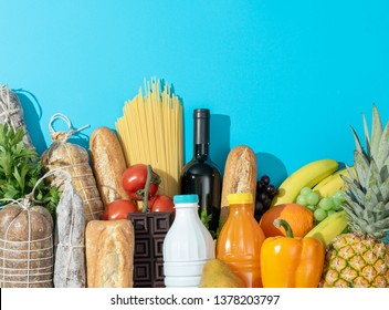 Fresh assorted grocery shopping items: vegetables, fruit, drinks, dairy and cured meat