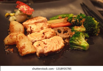 Fresh Assorted Seafood, Salmon Fillet, Scallop and Vegetable Teppanyaki Grill (Japanese cuisine that uses an iron griddle or hot fry pan to cook food) in traditional steakhouse. Food Cooking concept