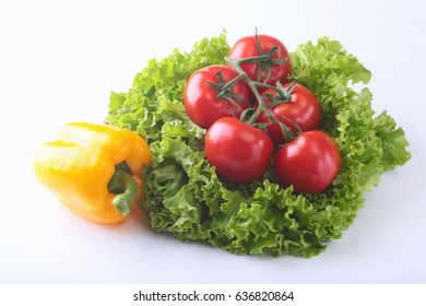 Fresh assorted vegetables bell pepper, tomato, garlic with leaf lettuce. Isolated on white background. Selective focus.