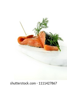 Fresh Atlantic Salmon fillets, salted and ready prepared for poaching or grilling. Dill garnish. Copy space.