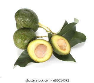 A fresh avocado in half on white background