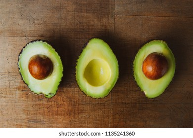 Fresh avocado on old wooden table