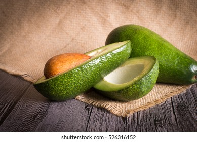 Fresh avocado on wooden background
