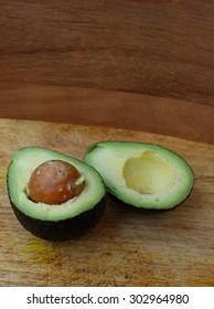 Fresh avocado stored on wooden background
