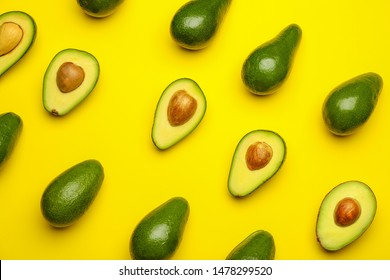 Fresh avocados on color background