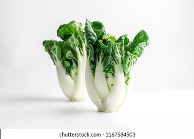Fresh baby Bok choi (Chinese cabbage) on white background