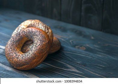 Fresh bagel with poppy seed on sackcloth. Russian traditional bakery product. or bakery pastry banner, ad, poster.
