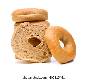 Fresh bagels on white background.