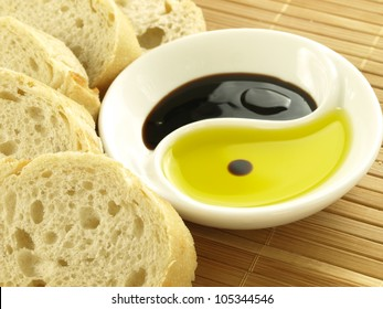Fresh baguette, olive oil and balsamic vinegar