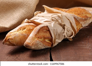 Fresh baguette on a wooden table