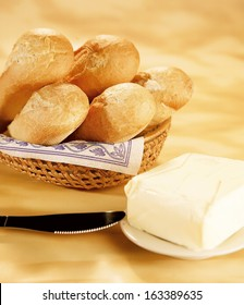 Fresh baguettes in a basket with butter