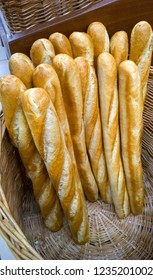 fresh baguettes long loaf in a wicker basket in a bakery store vertical