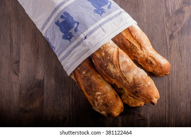 Fresh baked baguettes lined in a kitchen towel