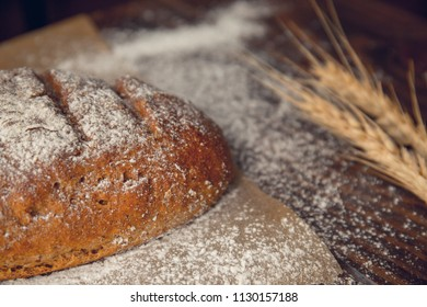 Fresh baked bread on wooden table background. Home made bread. Top view.