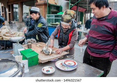 Fresh baked breads from the clay oven are displayed for sale on the side street market, Turpan, Xinjiang, One Belt One Road (OBOR), China, 3/24/11