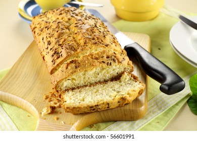 Fresh baked caraway seed loaf with tea ready to serve.