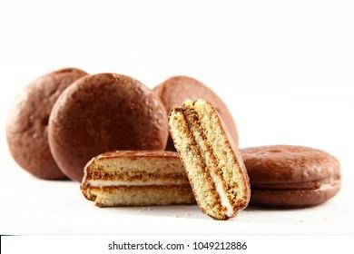 Fresh baked chocolate coated cakes on a white background, choco pie