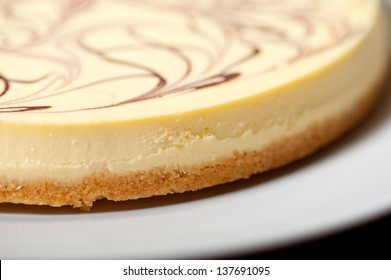 fresh baked classic Cheese cake with chocolate topping