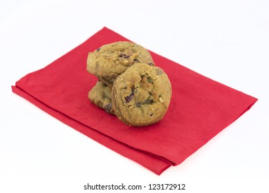 fresh baked cranberry walnut cookies on a red napkin