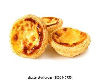 Fresh baked egg tarts or custard tarts (pastel de nata) isolated on white background