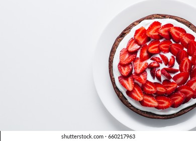 Fresh baked homemade pie with strawberries and whipped cream and cinnamon on rustic background. close-up. top or overhead view. Thanksgiving Desserts or cake sweet pastry. copy space.