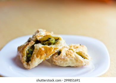 Fresh baked homemade puff pastry cakes with onion and egg