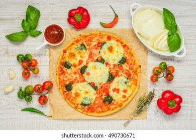 Fresh Baked Italian Cuisine Food Pizza with vegetables, miozzarella cheese, and Tomato sauce in Top View