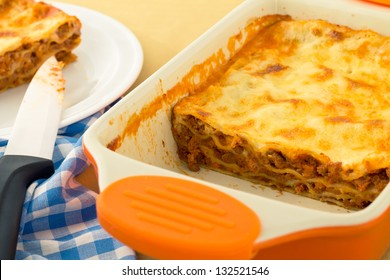 Fresh baked Italian lasagna with beef in a baking dish