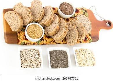 a fresh baked loaf of whole grains bread with poppy, flax and sunflower seeds