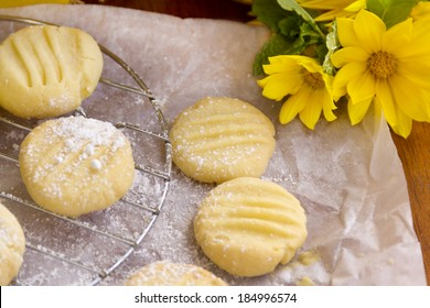 Fresh baked melting moments shortbread biscuits with icing sugar straight from the oven.