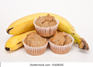 Fresh baked muffins from my oven - bunch of bananas - white background.