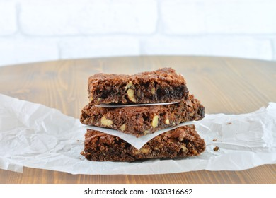Fresh baked nutty fudge brownie cake on wooden table