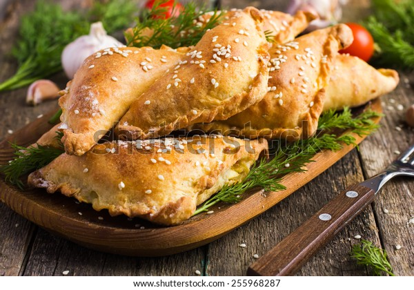 Fresh baked  pasties filled with meat and vegetables