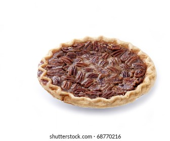 Fresh baked pecan pie isolated on white