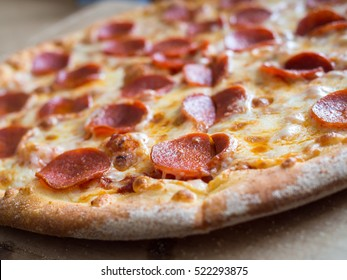 Fresh baked pepperoni pizza, shallow depth of field