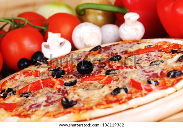 fresh baked pizza with pepperoni, olives and mushroom