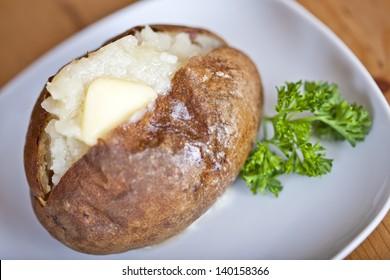 Fresh baked potato on a white plate