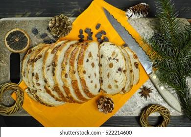 Fresh baked raisins bread sliced on granite board, Christmas holiday concept