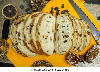 Fresh baked raisins bread sliced on granite board, ?hristmas holiday concept