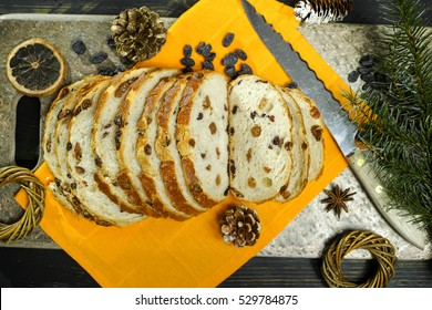 Fresh baked raisins bread sliced on granite board, holiday concept