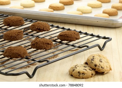 Fresh baked Stack of warm chocolate chips cookies, chocolate cookies and shortbread cookies shallow DOF