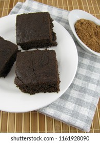 Fresh baked tasty dark carob cake on a plate