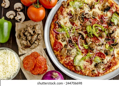 Fresh baked thin crust supreme pizza with fresh mushrooms, onions, green peppers, tomatoes, pepperoni, sausage and cheese