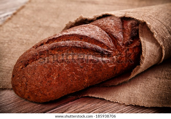 Fresh baked traditional bread on a burlap
