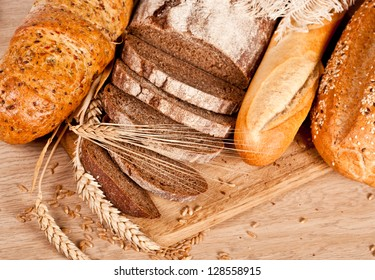 Fresh baked traditional bread and wheat
