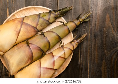 Fresh bamboo shoot on wooden plate
